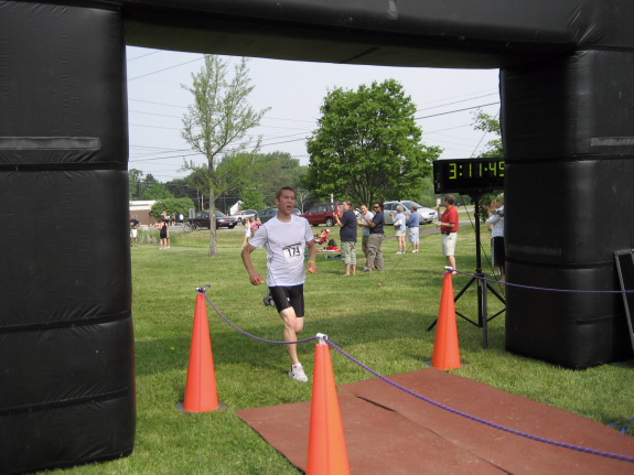 Zach finishing his first triathlon - June 3, 2007
